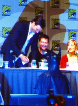 Tom Welling giving autograph to Batman