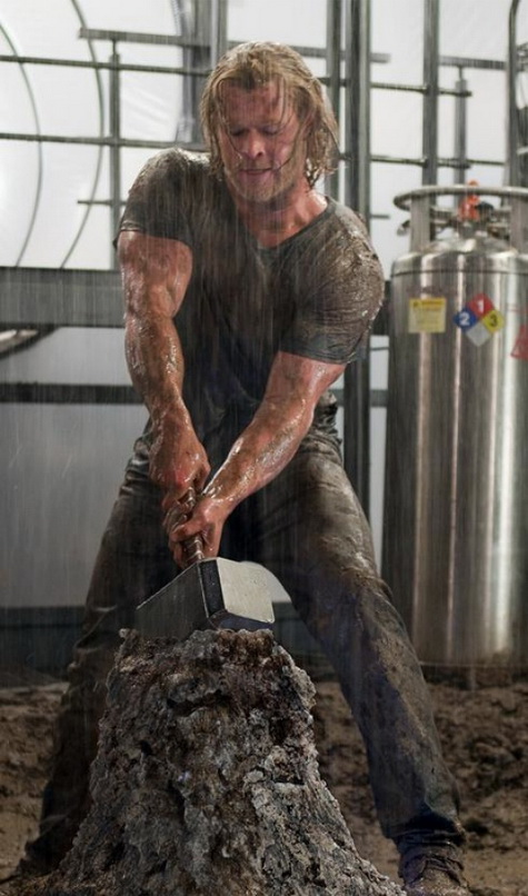 Chris Hemsworth in Thor, lifting Mjolnir