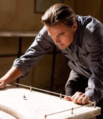 INCEPTION Leonardo DiCaprio stares at his top