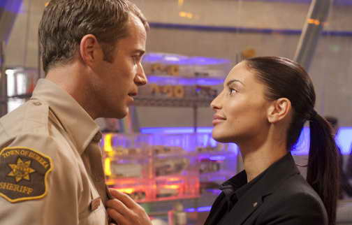 Pictured: (l-r) Colin Ferguson as Sheriff Jack Carter,  Erica Cerra as Deputy Jo Lupo in Eukreak - Season 5