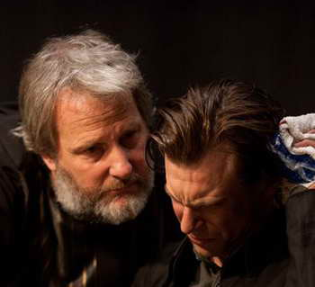 Jeff Daniels and Noah Segan in the movie Looper