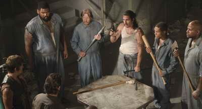a Still of Norman Reedus, Lew Temple, Markice Moore and Theodus Crane in The Walking Dead