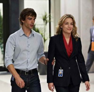 a production still of Piper Perabo and Christopher Gorham in Covert Affairs