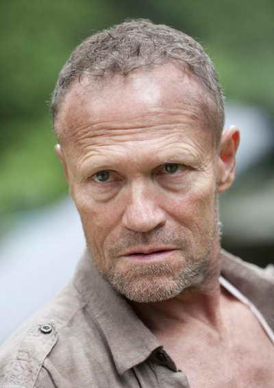 a still of Michael Rooker as Merle in The Walking Dead