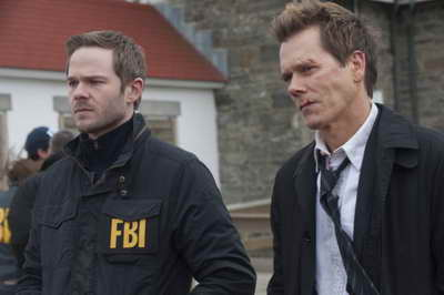 THE FOLLOWING: Weston (Shawn Ashmroe, L) and Ryan Hardy (Kevin Bacon, R) get closer to capturing Joe in the The Final Chapter season finale episode