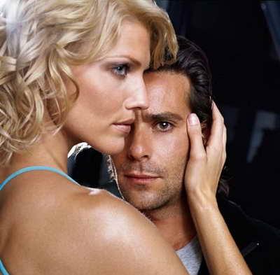 still of James Callis and Tricia Helfer in Battlestar Galactica