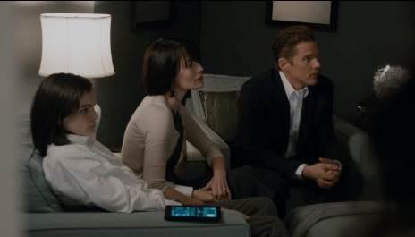 Ethan Hawke, Lena Headey and Max Burkholder in The Purge